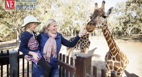 Mother and daugher enjoying a Giraffe Encounter experience at Taronga Western Plains Zoo, Dubbo