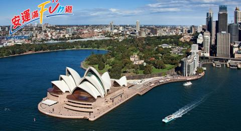 Aerial of Sydney harbour Opera House and Royal Botanic Gardens in the afternoon