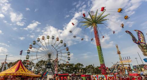 Crowds enjoying the carnival rides at the 2019 Sydney Royal Easter Show, Sydney Showground at Sydney Olympic Park