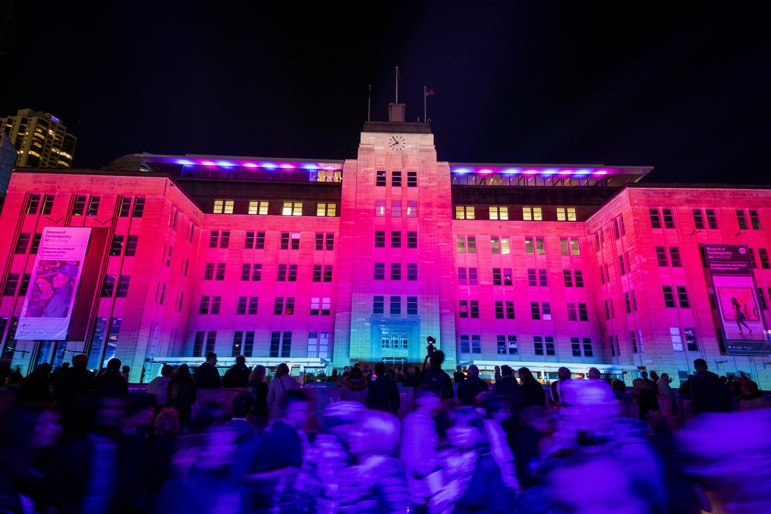 Crowds enjoying the Virtual Vibration light projection on the Museum of Contemporary Art Australia, The Rocks during Vivid Sydney 2018