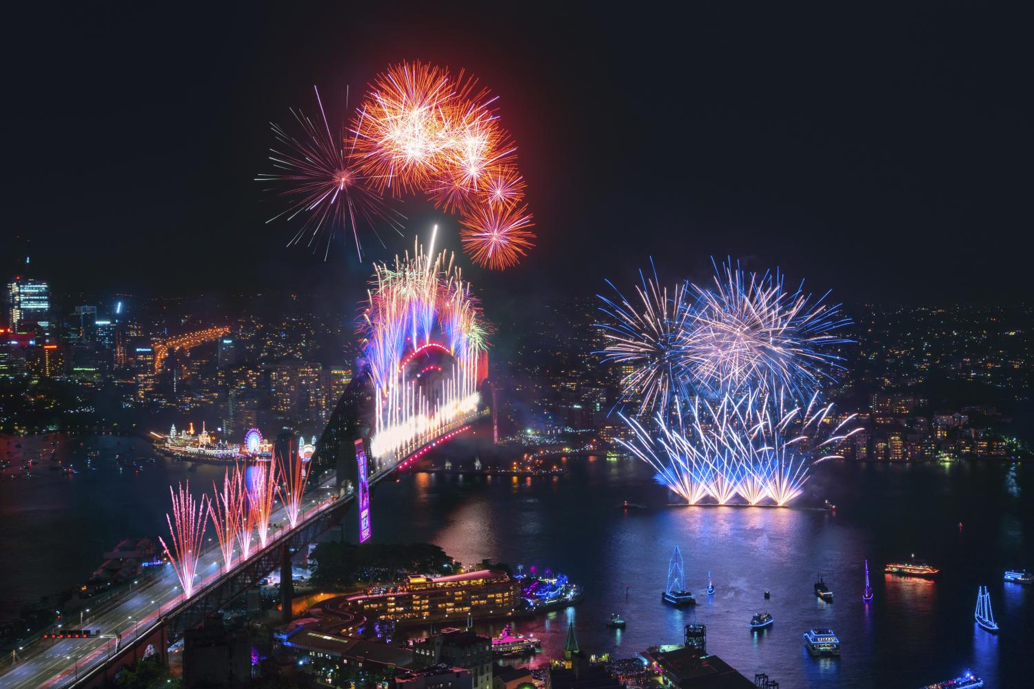 Spectacular midnight fireworks display across Sydney Harbour at to celebrate the start of the new year 2020