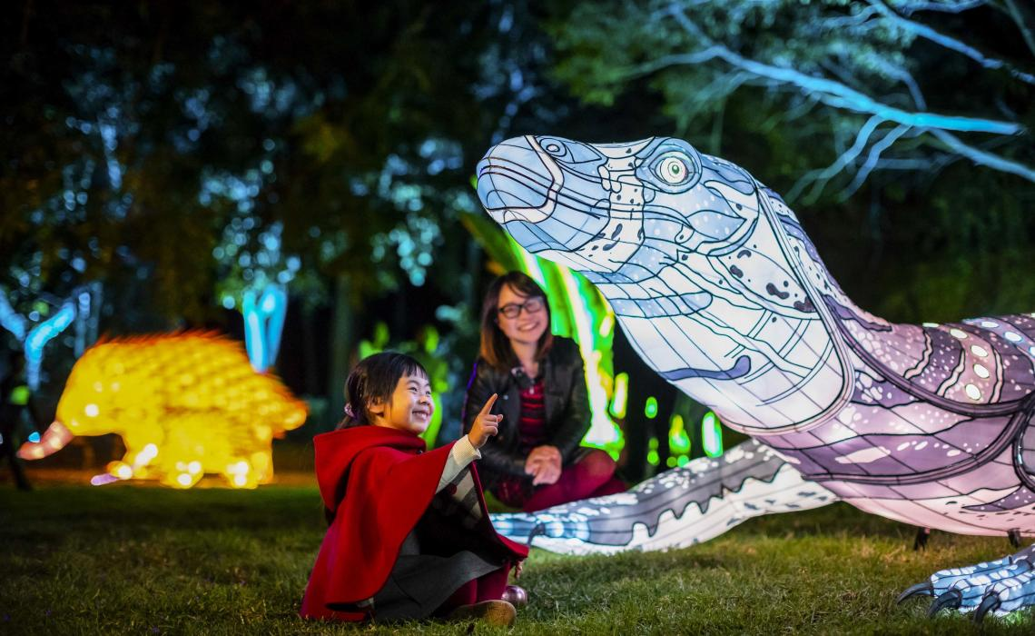 Mother and daughter enjoying a close encounter with the goanna light lantern installation at Taronga Zoo, Vivid Sydney 2018