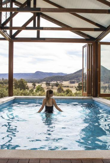 Woman relaxing in a seven metre-long private pool at Emirates One&Only Wolgan Valley